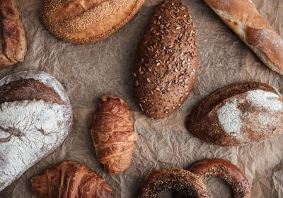 pastries-and-bread-with-flour-on-table-PG7BANZ